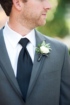 """...the groom and groomsmen wore ranunculus with a touch of rosemary. I wanted rosemary because it is said to increase memory, and I wanted to always have the memories from this day."""