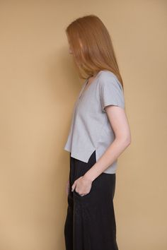 Ali Golden V-Neck Top in grey. Raw silk v-neck top with cap-sleeves, small side slits and center front seam detail. Back hem is slightly longer than front. M...