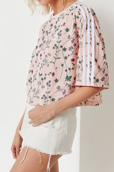 Shop adidas Originals Floral Cropped Tee at Urban Outfitters today. We  carry all the latest 31419844df832