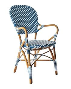 """<p><span style=""""line-height:1.6em"""">A classic 1930s European bistro chair, reinterpreted. Handcrafted of sustainable rattan and woven plastic seats, it's great for the kitchen or the patio. Look closely and you'll notice the wonderfully organic marks created while bending and stretching the rattan into shape – a time-honored technique perfected by the French. A chic mix of navy and white makes it at home practically anywhere. Try it with the other silhouettes in this collection..."""