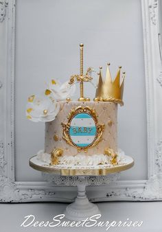 Baby gold cake with crown and carousel toppers More