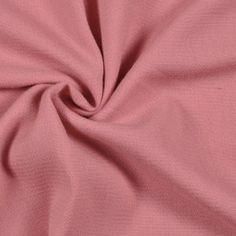 This is a medium weight, dense, wool crepe in a bubblegum pink. Great for a variety of apparel.