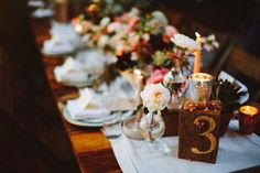 painted table numbers - photo by Pat Furey http://ruffledblog.com/brooklyn-wedding-with-breathtaking-floral-design