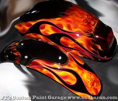 Motorcycle Tins with Fire under Flames by jtscustoms, via Flickr
