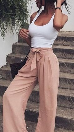 spring fashionable outfit idea / white top   bag   nude wide pants