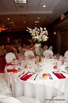 The Windsor Ballroom decorated in white and red for a recent New Jersey wedding. www.WindsorBallroom.com Photograph courtesy of Encore Entertainment #wedding #venue #ballroom #bride #groom #MercerCounty #NJ #NewJersey #EastWindsor #HolidayInn #ballroom #weddingcake