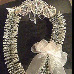 MONEY LEI. Hand-made with love. Made of authentic US Dollar bills in $1, $5, $10 bills for graduation.