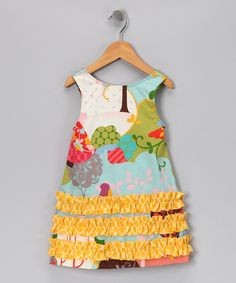 I must make a Ruthie dress with these rows of ruffles.  So cute!