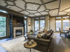 The first-floor living area has quatrefoil ceiling, fireplace, hand-scraped and custom-stained floors, French doors opening to the completely redesigned garden and patio plus an open kitchen with stainless steel appliances and Sub-Zero refrigerator.