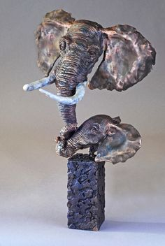 """Zuri- A bronze sculpture by Mark Hopkins    In Swahili, Zuri means """"good"""" or """"beautiful.""""    And what is more good or beautiful to a mother than her child?    15x9x10 inches"""