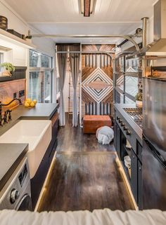 """One owner is a chef, so they spared no expense in the gourmet kitchen, which includes a 36"""" Wolf cooktop, apron sink, copper backsplashes, and a hidden dishwasher."""