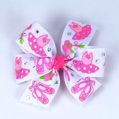 Every little dancer should have this bow!  I love the shiny silver details on the ribbon!