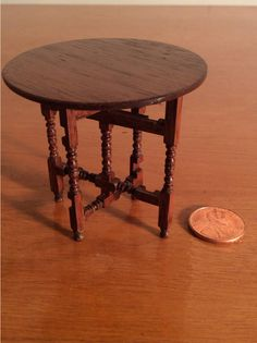 Gerald Crawford - round gateleg folding table; sold on ebay for $158.50