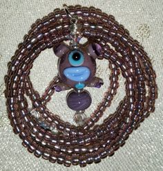 Check out this item in my Etsy shop https://www.etsy.com/listing/112790368/on-sale-purple-alien-necklace