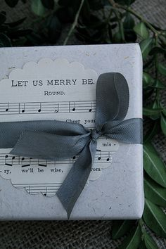 Print out Christmas Carol sheet music in reds, greens, greys, and golds for your packages. Love this idea
