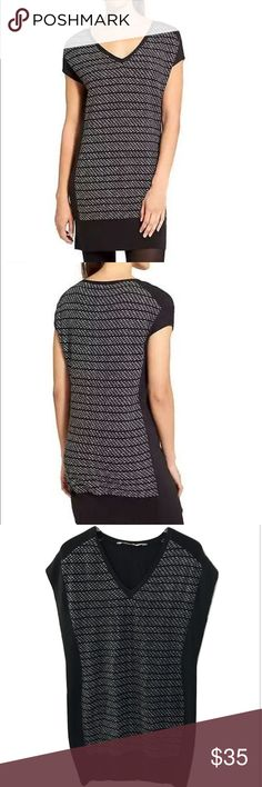 """Athleta Wherever Sweater Dress Short Sleeve tunic Black Thereafter Sweater Dress V-Neck Short Sleeve   Black   Medium    Fit & Sizing  Relaxed fit  Fits loose throughout, hits above the knee  Body length in size medium: 35""""    PRODUCT DETAILS  This short-sleeve sweater dress with a casual, freeing fit is the perfect layer to throw on for cool-not-cold days.  INSPIRED FOR: adventure To Fro  Sporty short sleeves for shoulder coverage  V-neck front  Colorblocking along sides  #362821   FABRIC…"""
