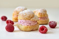 Raspberry Cream Puffs - Little Swiss Baker. Spring is here, the perfect time for choux pastry, a shell of light pastry filled with raspberry whipped cream. Raspberry cream puffs are light and airy with a creamy filling and a hint of raspberry.