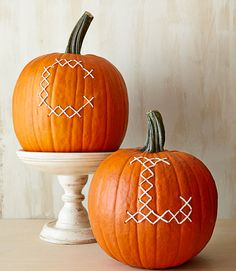 "Personalize your pumpkin with a little embroidery. How to make it: Cut a hole in the bottom of a large pumpkin and scoop out pulp and seeds. Using an erasable wax pencil, draw a series of Xs to create your desired letter. (Try the alphabet tool at stitchpoint.com for inspiration.) Use a small drill bit to pierce holes at the ""corners""of each X. Using a large needle, thread butcher's twine through the openings in an ""x"" pattern to create a cross-stitched effect.   - CountryLiving.com"