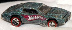 Most Expensive Hot Wheels Car The custom-made jewelled car is valued at US$140,000, and cast in 18-k white gold. It includes more than 2,700 diamonds that weigh nearly 23 carats total.