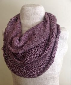 Just as infinity scarves have quickly become a must-have item for every wardrobe, a knit infinity scarf pattern is a necessity for every knitter's repertoire. The Burnished Rose Infinity Scarf has a stockinette stitch body for warmth with lacy edges that give it a deceptively delicate appearance.