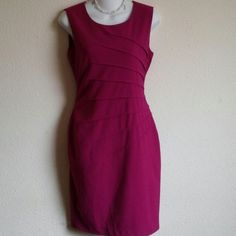 Calvin Klein magenta starburst dress Beautiful starburst pleated pattern on side of dress in magenta color size 2. Sleeveless with hidden back zipper closure. Measurements from top to hem is 37 inches in length. This dress is lined. 63% polyester 33% rayon and 4% spandex. Calvin Klein Dresses