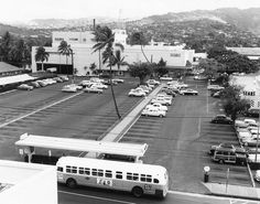 Honolulu, Hawaii: 1959    19 March 1959 photo of the old Sears and Roebuck building and parking lot on Beretania, Young and King Streets and later in 1967 converted into the Honolulu Police Department. later the building was torn down and a high rise conominium now is at that location. The parking lot in the foreground is today the Pawaa Neighborhood Park .