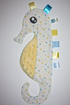 Items similar to Seahorse Ribbon blanket blue and yellow stars with yellow minky dot tummy on Etsy Quilt Baby, Sewing To Sell, Sewing For Kids, Sewing Toys, Sewing Crafts, Tag Blankets For Babies, Baby Sewing Projects, Blue Blanket, Stuffed Animal Patterns