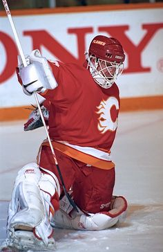 Mike Vernon of the Calgary Flames stops a shot against the Toronto Maple Leafs during preseason game action on September 24 1991 at Maple Leaf. Ice Hockey Teams, Hockey Goalie, Hockey Games, Calgary, Flame Picture, Nhl Wallpaper, Goalie Mask, Good Old Times, New Jersey Devils