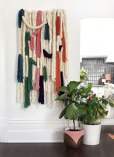 Make a bold statement with this wrapped wool wall hanging. Very big on impact but surprisingly easy to make - you don't need any craft skills! DIY tutorial.