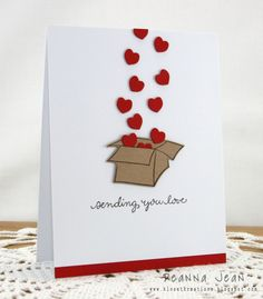 To have the hearts look like they are coming out of the top of the box, cut a slit in the top of it. This allows you to tuck the first couple of hearts inside.