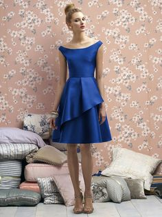 Off the shoulder, knee length, sapphire-colored bridesmaid dress in silk blend.