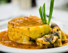 Cou cou and flying fish is the National Dish of Barbados.  It is a recipe made with corn meal, okra, flying fish and topped with an aromatic sauce of tomato, thyme, fresh pepper, onions, chives, garlic and other herbs.  The fish can be steamed, battered & fried or grilled.