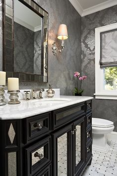 Kohler Margeux Collection Faucet, antique tiled wall mirror, grey foil wallpaper.