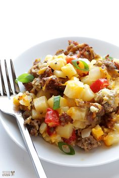 Easy Cheesy Breakfast Casserole. Eggs, milk, hash browns, sausage, red bell pepper, onion, cheddar cheese