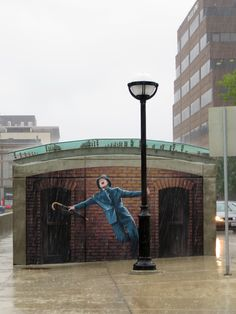 Coolest street art. Gene Kelly mural in Ann Arbor - More permanent than David Zinn's usual (chalk) artwork