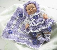 Design by: Maggie Weldon Skill Level: Easy Size: Fits doll; White - 1 ¾ oz, 160 yd g, 146 m); Lilac - 3 ½ oz, 320 yd g, Crochet Doll Pattern, Easy Crochet Patterns, Crochet Dolls, Doll Patterns, Clothing Patterns, Baby Doll Clothes, Crochet Doll Clothes, Barbie Clothes, Baby Dolls