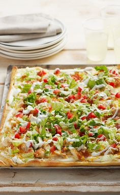 Chicken Club Pizza ~ Chicken, bacon, lettuce and tomato come together for a deli fave translated into a melty, hot pizza. Get all the flavors of a delicious club sandwich in every bite.