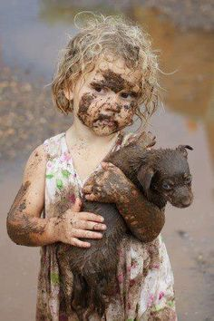 I have a feeling my kids will look just like this: muddy with some sort of animal in their arms