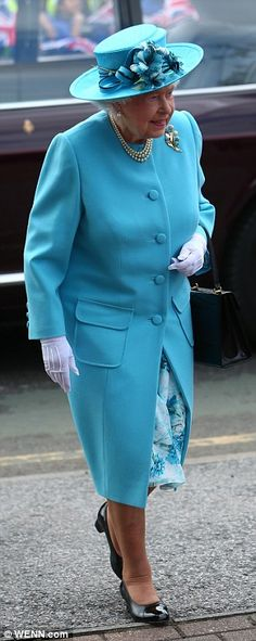 Looking good: Her Majesty was resplendent in an elegant turquoise ensemble topped with a matching hat