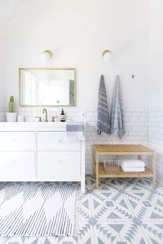 modern white bathroom renovation complete with patterned cement tile Photography : Jen Ha of Hello Hoku Read More on SMP: http://www.stylemepretty.com/living/2016/08/04/calling-all-patterned-tile-lovers-this-bath-reno-will-steal-your-heart/