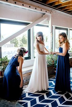 Bride getting ready with bridesmaids in navy dresses - The Loft at Union/Pine
