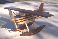 "Toy Float PlaneThe plane measures 10"" long with an 11"" wingspan. I used ash and walnut with a spray lacquer finish."