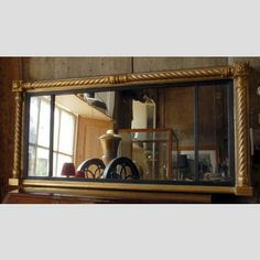 A Regency gilt tripartite overmantle mirror
