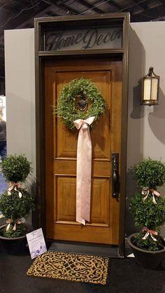 Long ribbon on a simple wreath...very pretty.