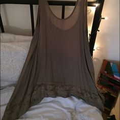Lace trim Free People top Adorable and versatile lace trimmed top. Great with leggings - can be dressed up or down. Color is olive green. Free People Tops Tank Tops