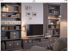 Tv bench, like the large units and the lighting. Plus the neutral grey colour.