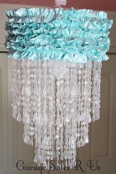 DIY Chandelier using a lampshade frame, ruffles, beads, and crystals