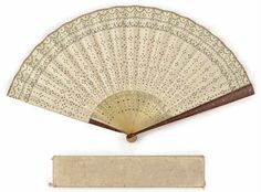 A folding horn and sequined paper fan, with box. Owned by Mary Todd Lincoln