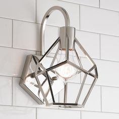 "Young House Love Geometric Diamond Sconce Add a modern edge to your home with the geometric diamond design of this Young House Love sconce. Check out our matching flush mount and lantern to complete the look! Available in Chrome or Bronze. 60 watt max medium base socket. (10.75""Hx6.5""Wx8""E)"