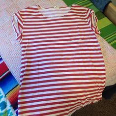Levi's horizontal stripe top Worn only a few times. Got this when I was in Bangalore, India. Longer than a usual top + looks great with leggings. Levi's Tops Tees - Short Sleeve